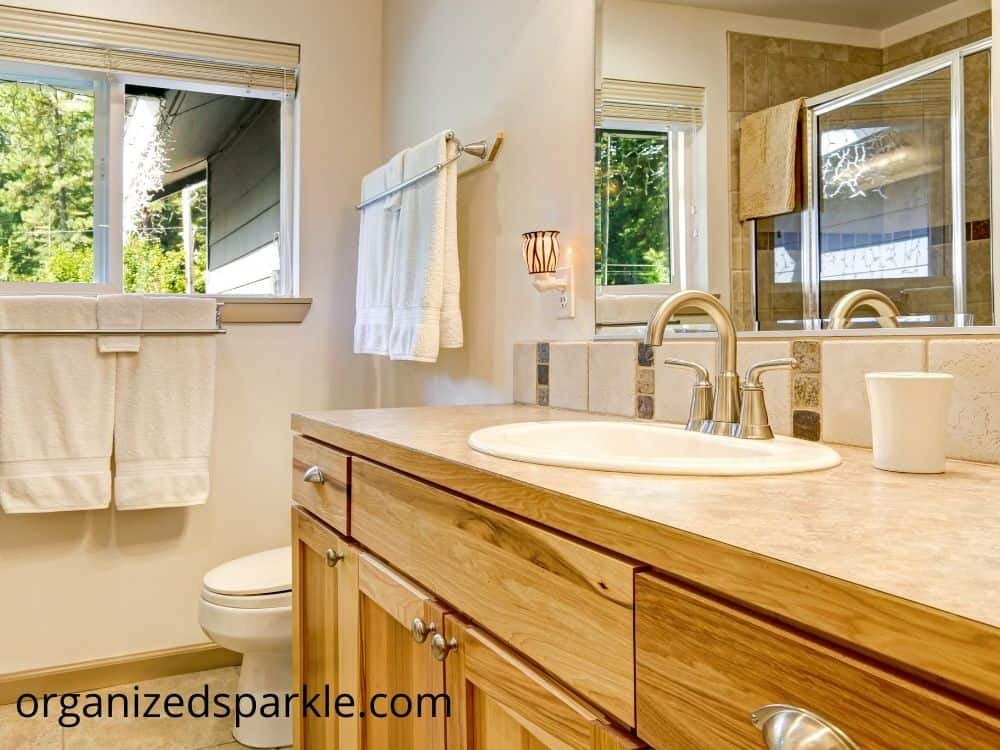 picute of classic bathroom with wooden vanity
