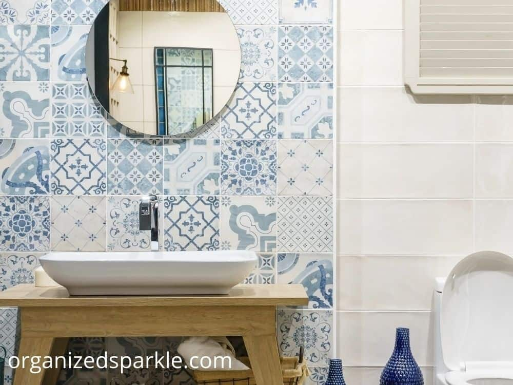 small bathroom with blue and white tiles