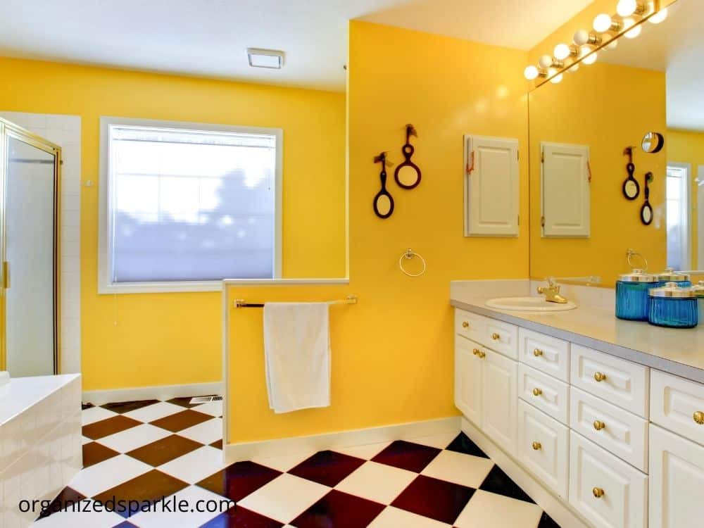 white, black and yellow bathrooms