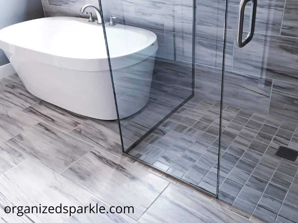 white and gray bathroom freestanding tub with separate shower