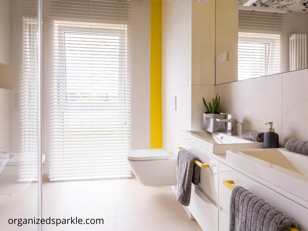 bathroom with yellow wall highlighted