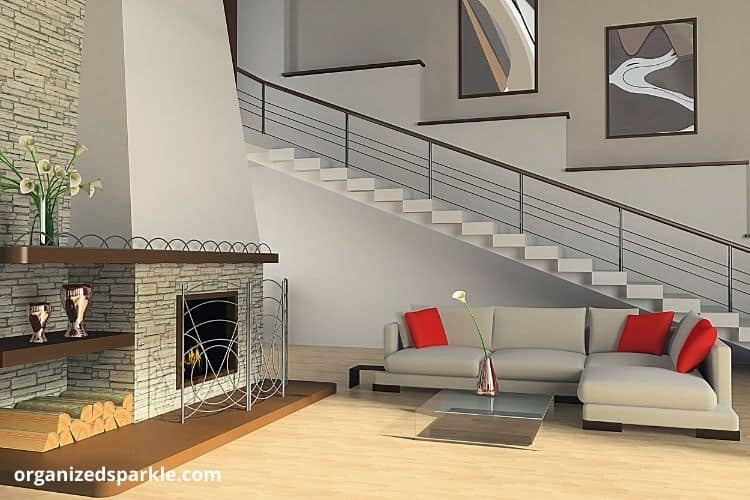 example of a living room with cozy seating and a stone fireplace