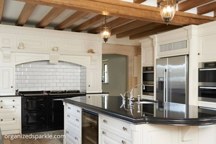 black and white Kitchen With Exposed Wood Ceiling Beams