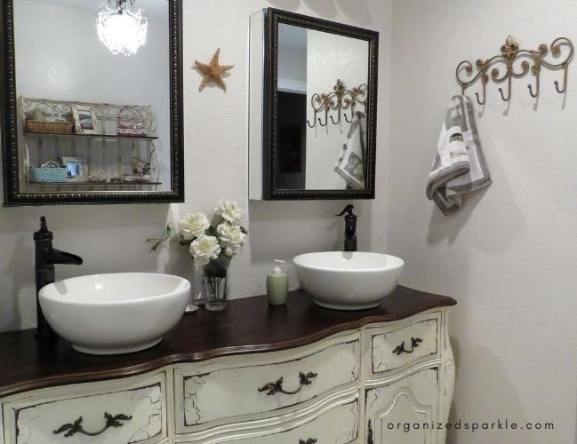 picture of a master bathroom with two vessel sinks on a vanity unit